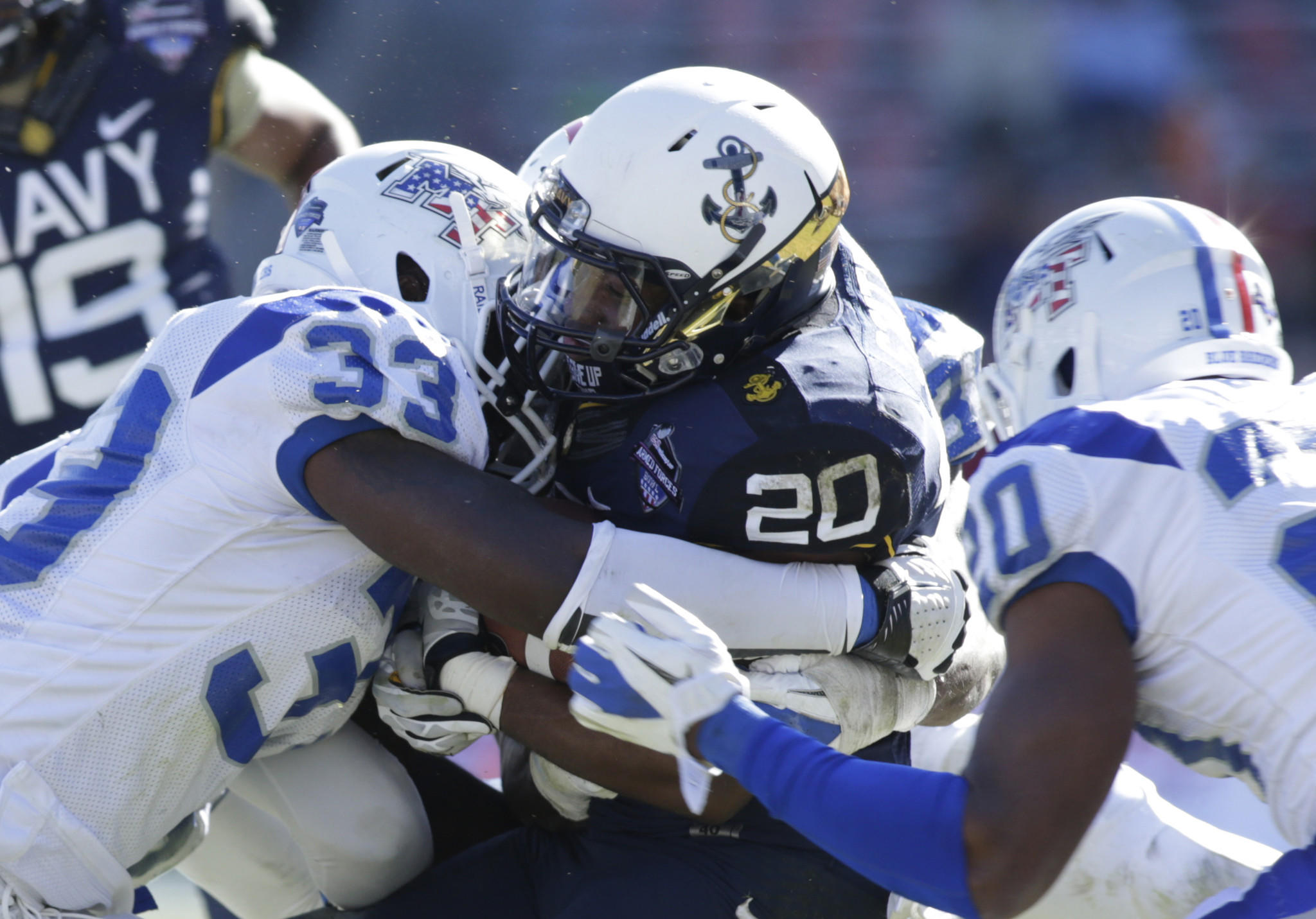 Middle Tennessee State's Roderic Blunt (33) tackles Navy's Darius Staten in the second quarter of the Armed Forces Bowl. Blunt was later ejected after a penalty-filled game.