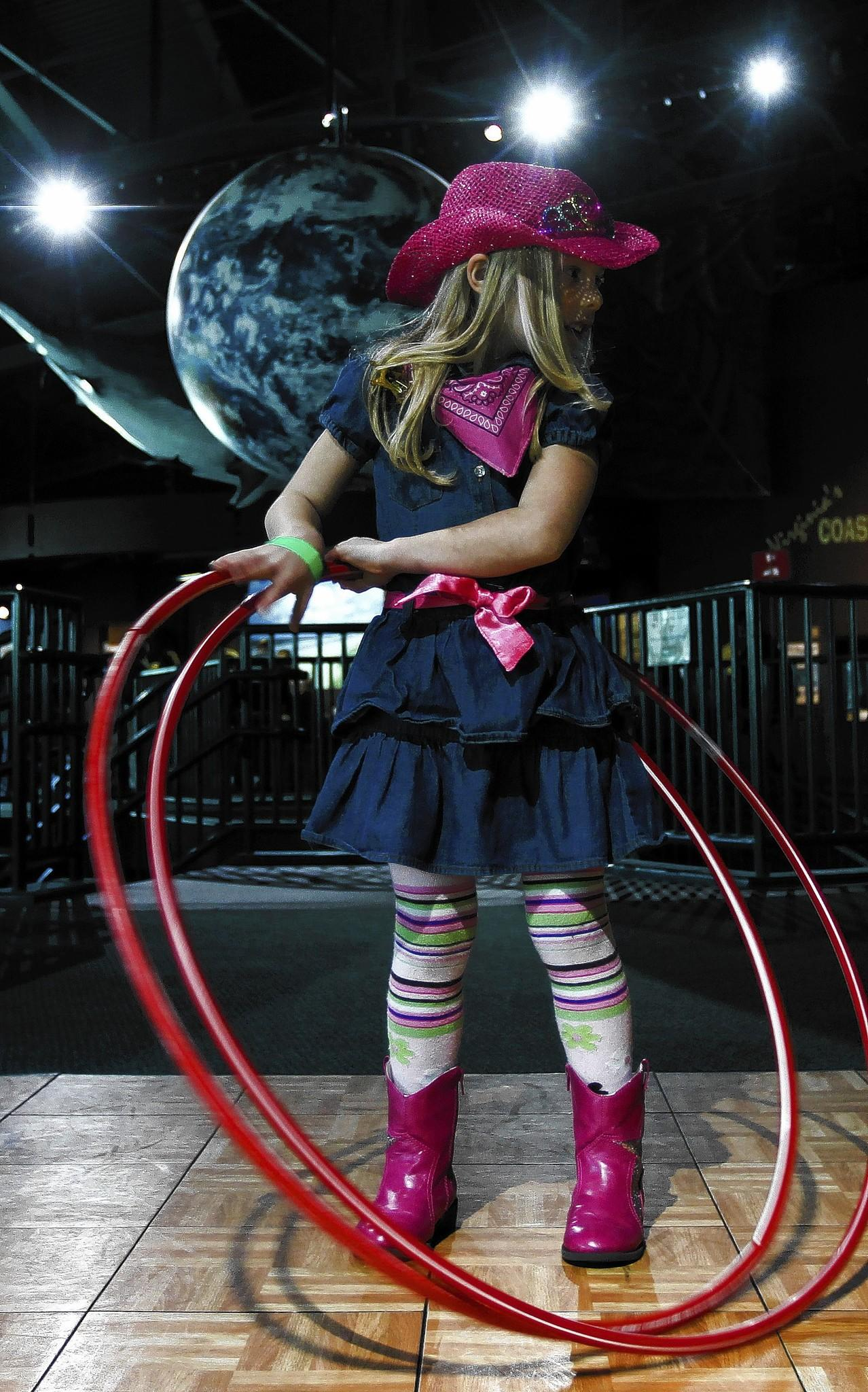 Alex Schaberl, 5, participates in a hula-hooping competition at the High Noon Year's Eve celebration at the Virginia Living Museum on Tuesday.