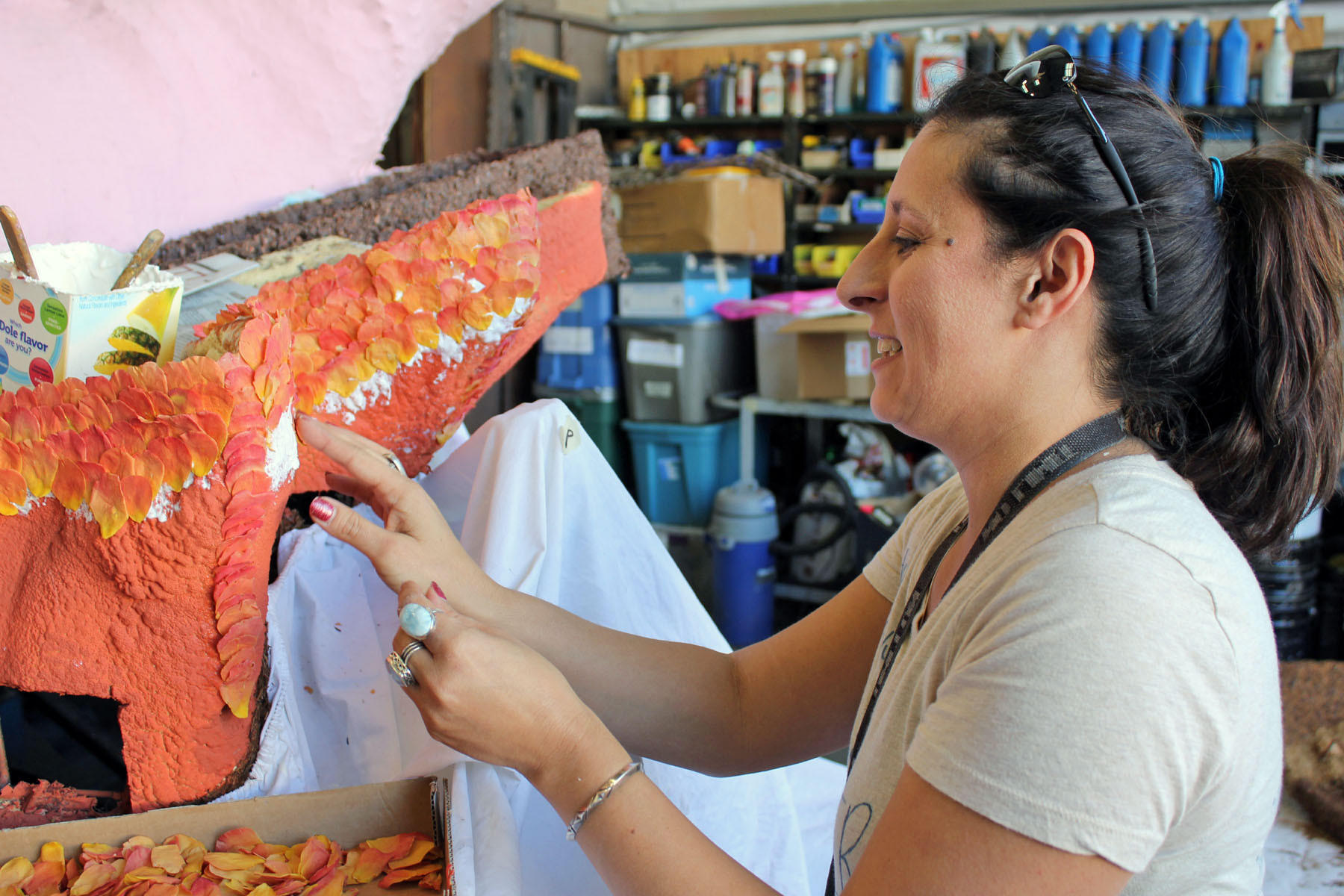 Jennifer Tripet applies freeze-dried rose petals to Burbank's Rose Parade float on Saturday.