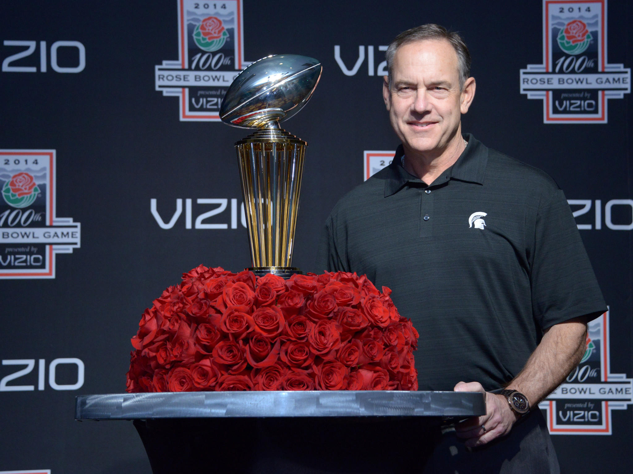 Michigan State coach Mark Dantonio poses with the Leishman Trophy at press conference for the 100th Rose Bowl at LA Hotel Downtown.
