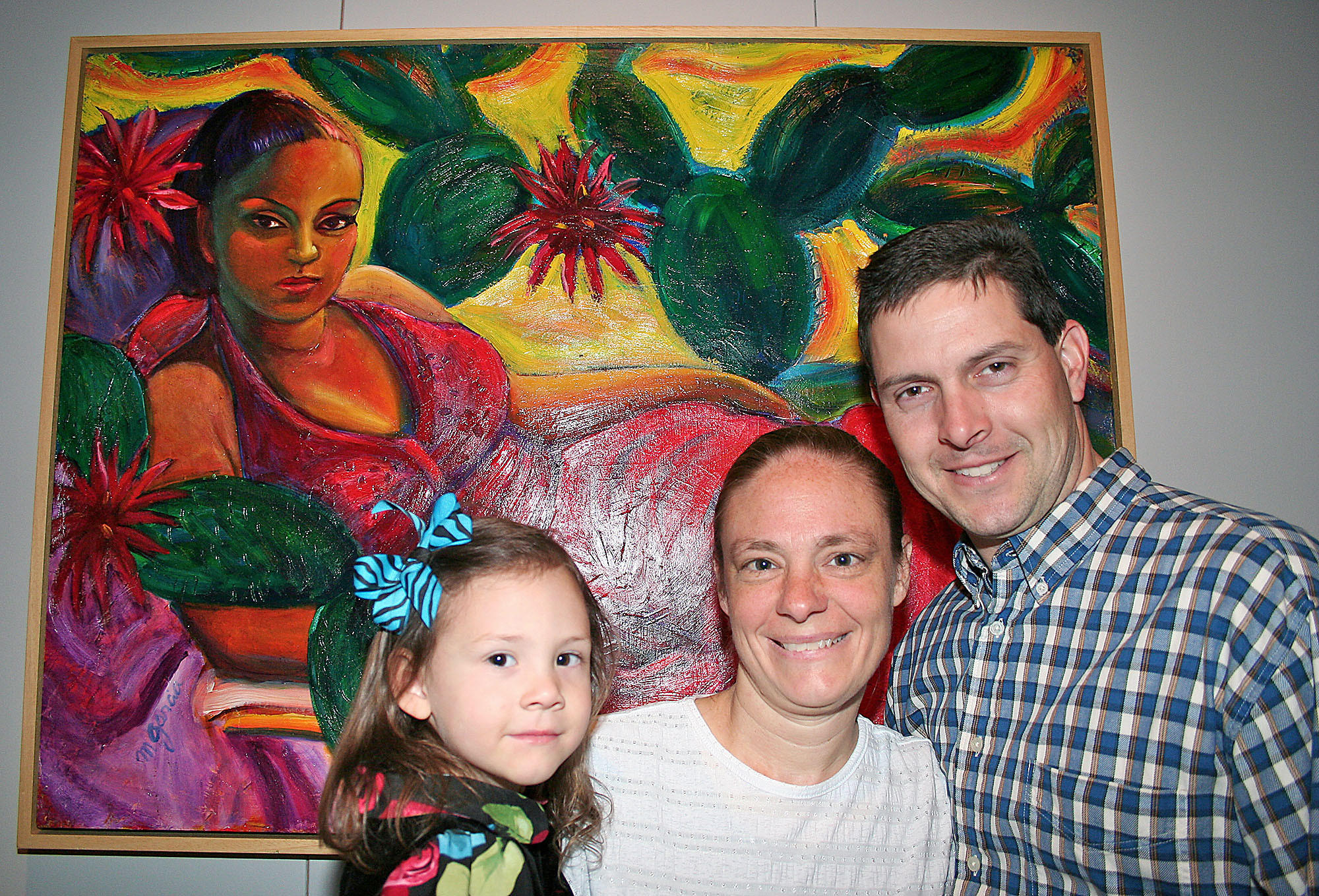 "Posing in front of ""The Woman is a Doctor"" by artist Margaret Garcia are Glassell Park family members Allison Kurtz, 3; mom Bonnie Kurts; and dad Sam Kurtz."