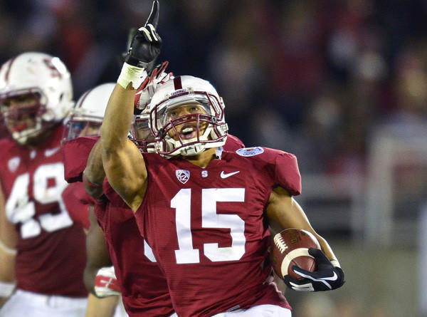 Stanford defensive back Usua Amanam celebrates after intercepting a pass by Wisconsin late in the Rose Bowl game last year.