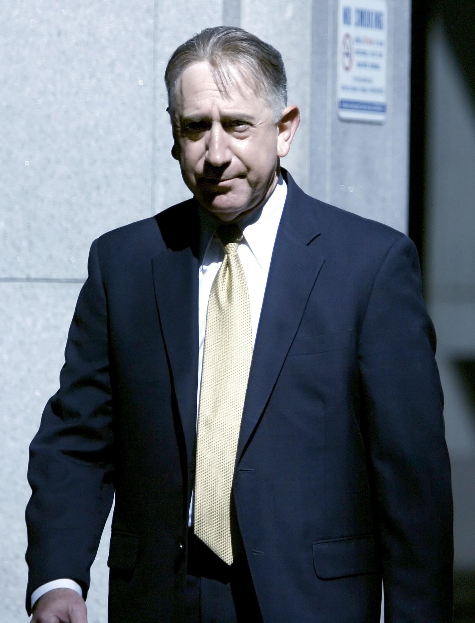 Former Glendale city councilmember John Drayman arrives at the C. S. Foltz Criminal Justice Center in Los Angeles to be arraigned on charges on Tuesday, May 8, 2012.