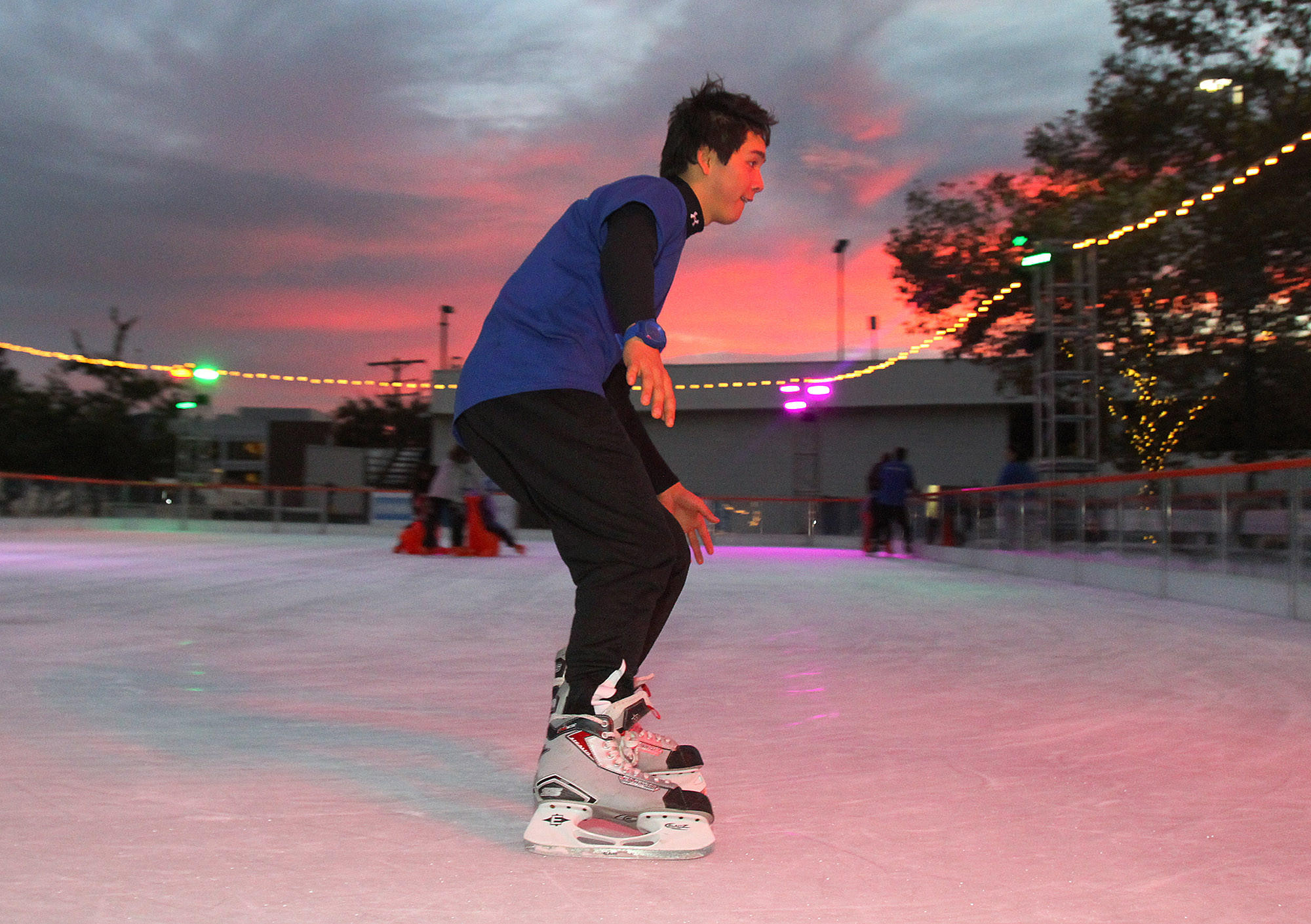 Jeremy Steele, 19, of Burbank, is a skate guard with Skate America, doing some very fast laps on an ice rink behind Burbank City Hall on Friday, November 22, 2013.