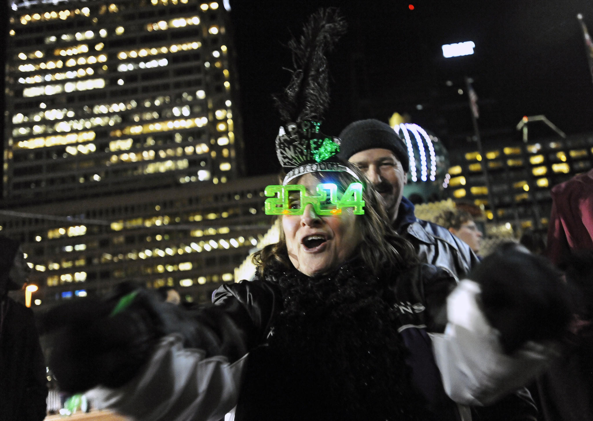 Rose Ettlin and husband John Kelly, of Baltimore dance to the music of Alter Ego during New Year's eve celebration at the Inner Harbor to welcome in 2014.