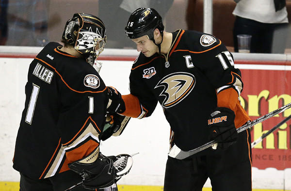 Ducks captain Ryan Getzlaf (15) congratulates goalie Jonas Hiller after a 6-3 victory over the Sharks on Tuesday evening in Anaheim.