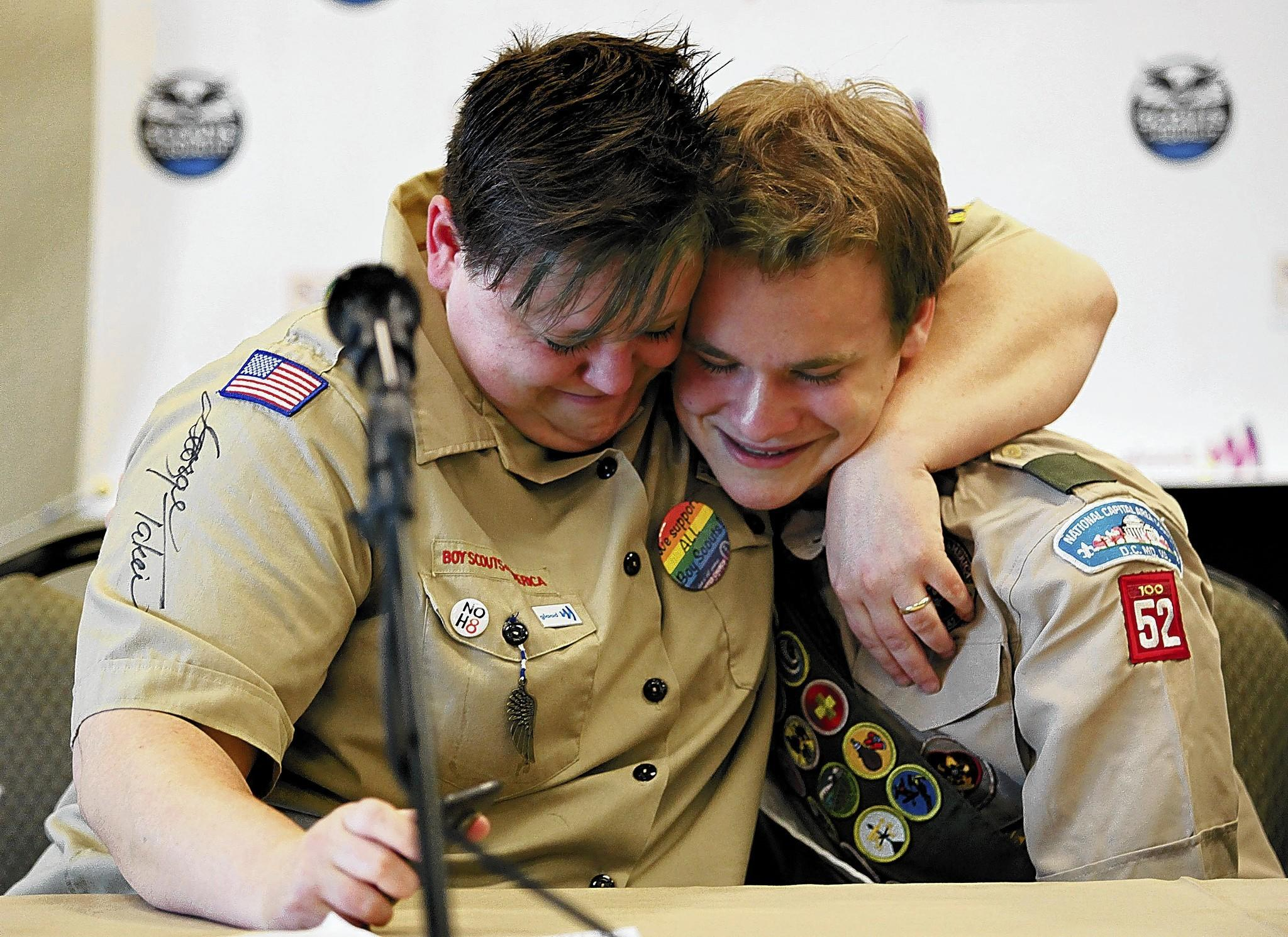 Jennifer Tyrrell hugs Pascal Tessier in May at a news conference in Grapevine, Texas, marking the end of the Boy Scouts' ban on openly gay youths. Tyrrell's ouster as a lesbian Cub Scout den leader will remain in effect.