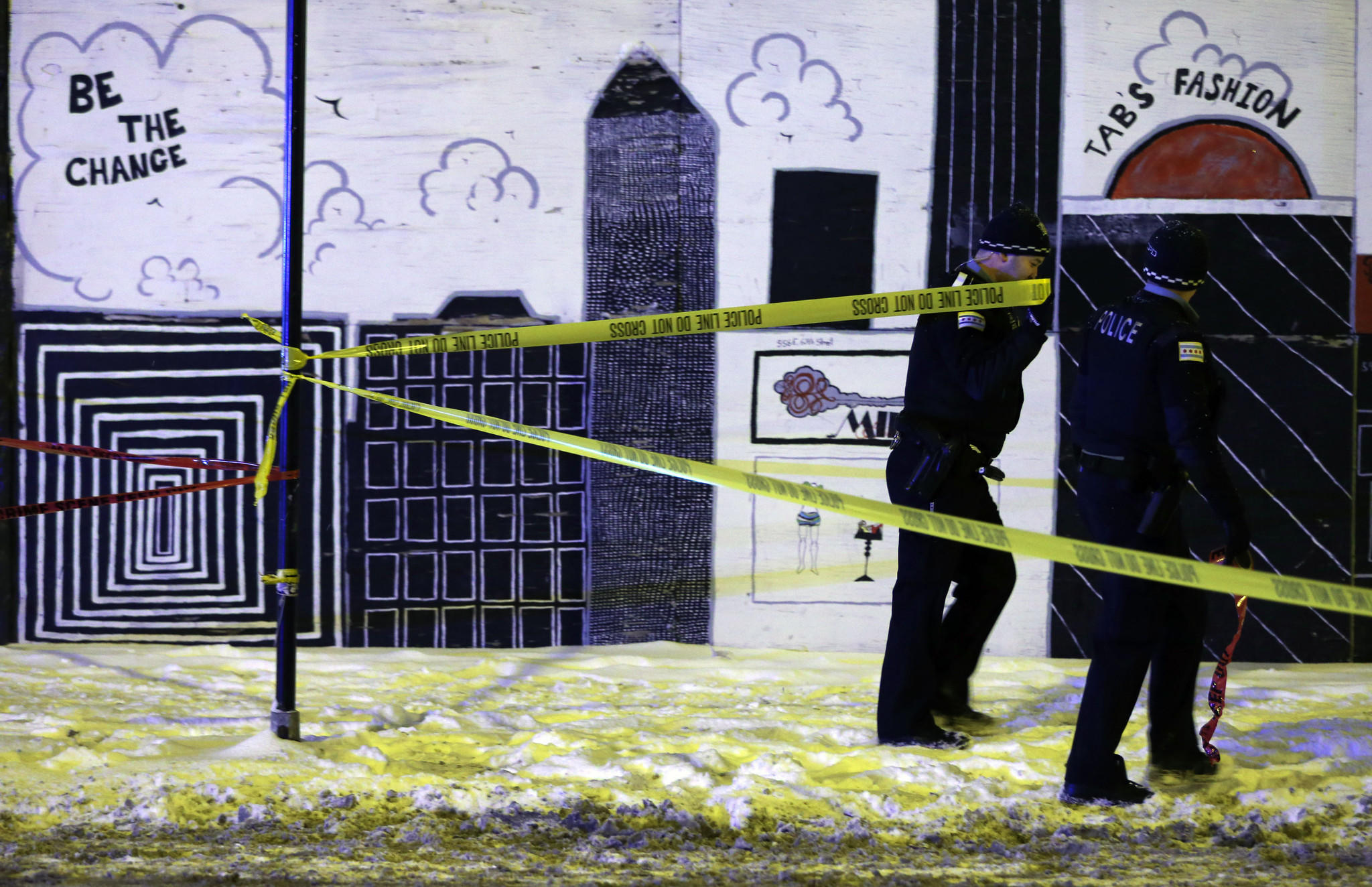 Police secure the scene of an officer-involved shooting on East 67th Street near Rhodes Avenue in Chicago overnight on Wednesday, Jan. 1, 2014.
