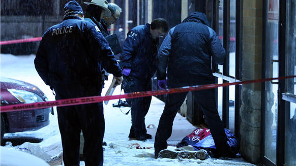 Chicago Police work the scene of a murder in the 7100 block of South Vincennes Avenue overnight in Chicago on Tuesday, December 31, 2013.