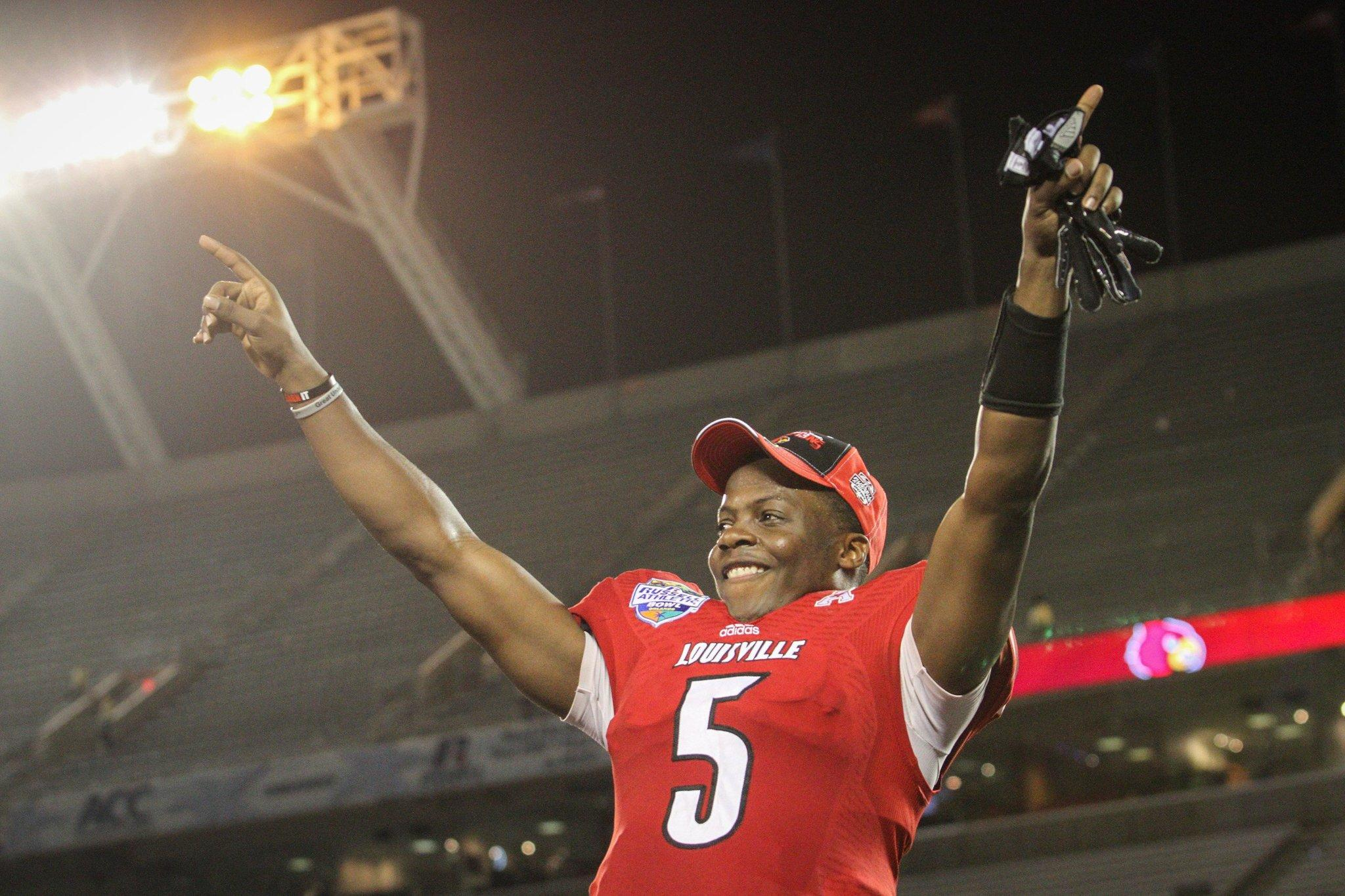 Louisville quarterback Teddy Bridgewater celebrates after defeating Miami, 36-9, in the Russell Athletic Bowl.