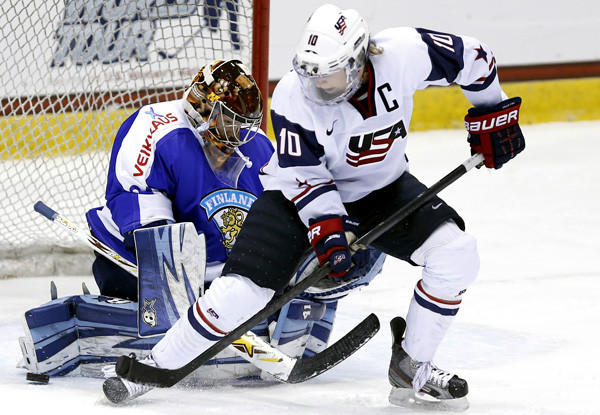 U.S. captain Meghan Duggan looks to score near the crease against Finland goalie Noora Raty during the third period of a Four Nations Cup game this fall.