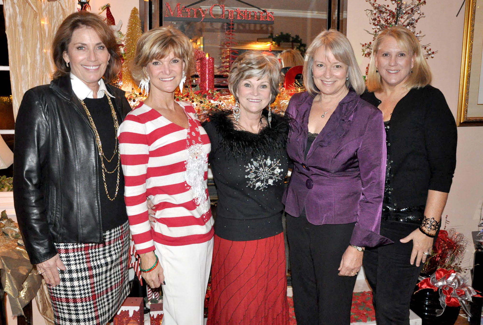Los Altos Auxiliary members of the Hathaway-Sycamores Residential Facility, gather for its annual Christmas party. Pam MacDonald, event chair, from left, Sandi Melin and Karen Sellergren, co-hosts of the party, along with co-presidents Laurie Rodli and Jennifer Herzer, are ready to party.