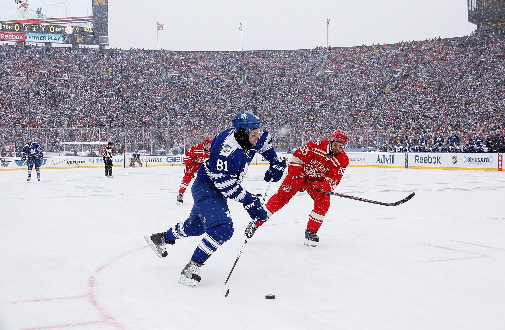 Phil Kessel of the Toronto Maple Leafs heads up ice while Niklas Kronwall of the Detroit Red Wings gives chase.