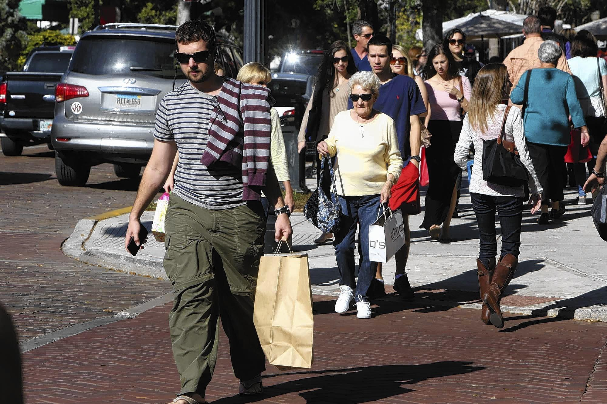 Christmas shoppers on Park Avenue in Winter Park on Dec. 20, 2013.