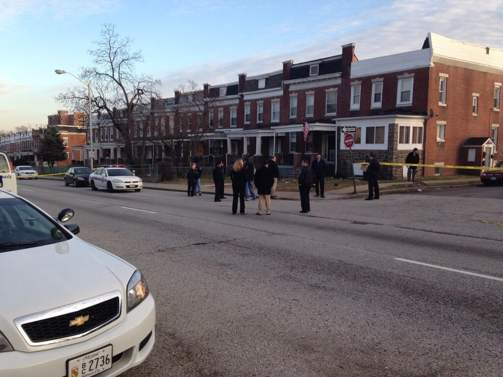 People congregate at the 3900 block of Edmondson Ave., the scene of Baltimore's first homicides of 2014.