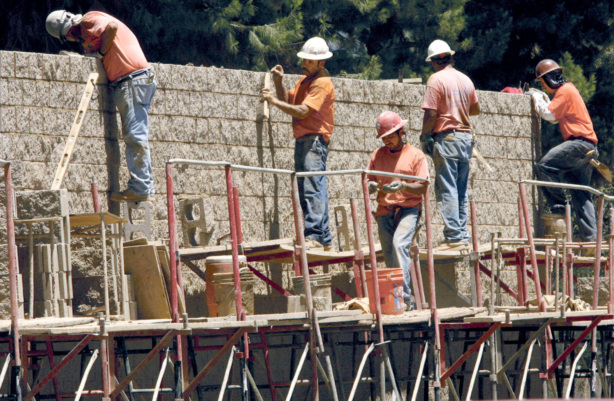 Construction workers put up a sound wall along the 134 freeway and Kenwood Pl. on Thursday, July 19, 2007.