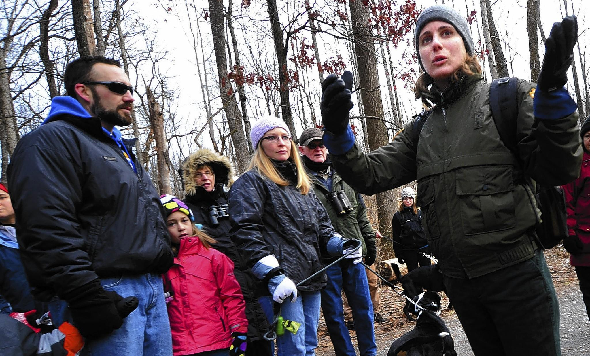 Jacobsburg Environmental Education Center educator Lauren Forster leads visitors on a 2.5 mile interpretive hike at the state park. Hikers learned about the old growth forest of Henry's Woods and the fields of the Homestead Trail.