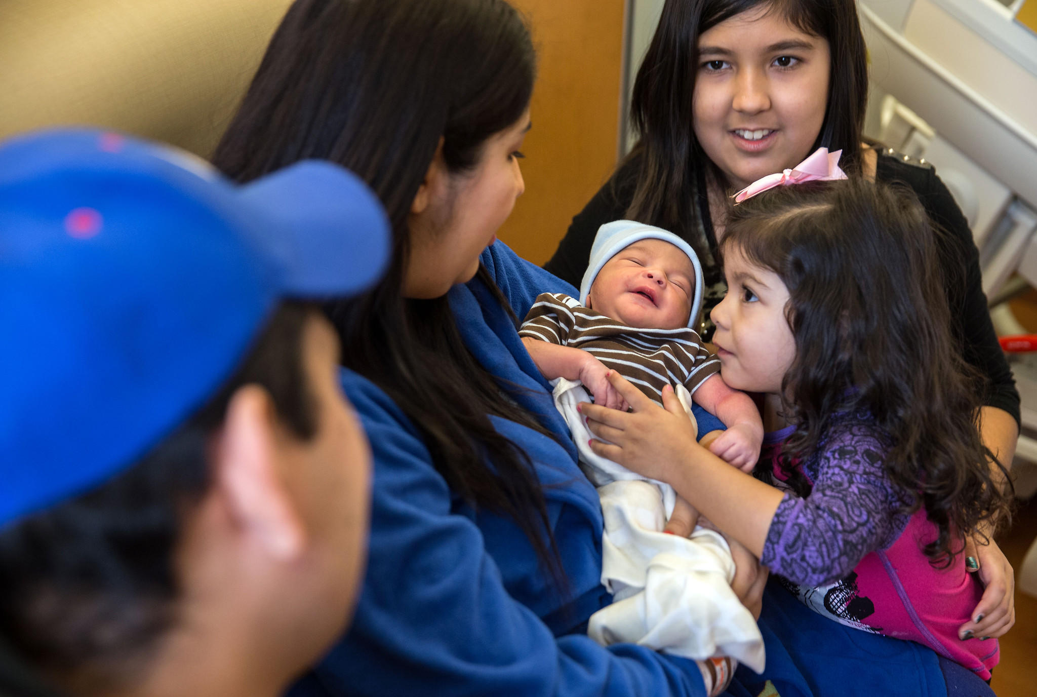 Luz Marquez, with husband Luis Marquez and daughters Aridahi, 11, and Yamileth, 3, holds Luis Anthony at Resurrection Hospital.