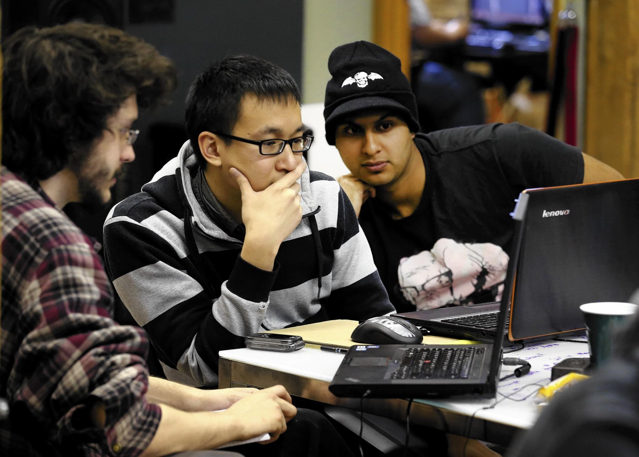 Zach Cassity, from left, John Pantaleon and Sahir Irfan participate in a game jam at The Nerdery in Chicago in October.