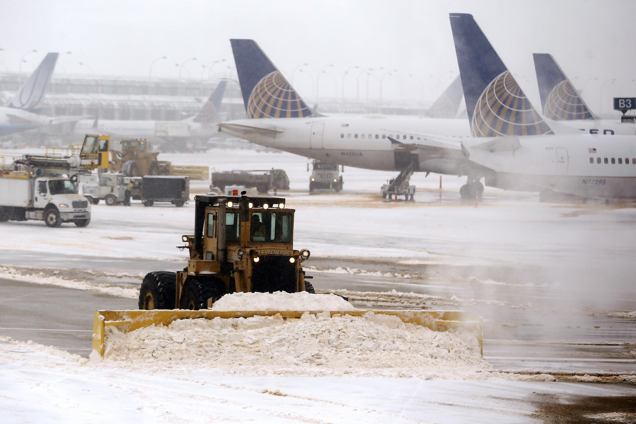 Crews plow at O'Hare International Airport in Chicago.