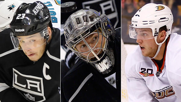 Kings teammates Dustin Brown, left, and Jonathan Quick and Ducks defenseman Cam Fowler were among the players named to the U.S. Olympic hockey team on Wednesday.