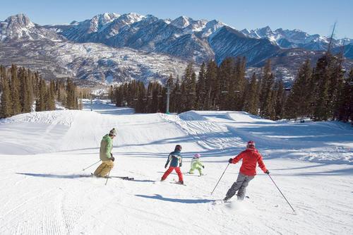 Family skiing the Needles Mountains, Durango.