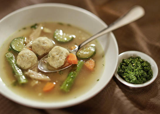 "A comforting bowl of chicken soup with matzo balls. Recipe <a href=""http://recipes.latimes.com/recipe-sephardi-chicken-soup-with-herb-flecked-kneidelach/""><strong>here</strong></a>."