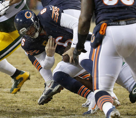 Jay Cutler is sacked by the Green Bay Packers defense in the second quarter at Soldier Field.