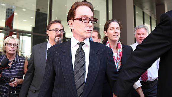 Beanie Babies founder Ty Warner is escorted to an awaiting car after pleading guilty to felony tax evasion in October at the Dirksen U.S. Courthouse in Chicago.