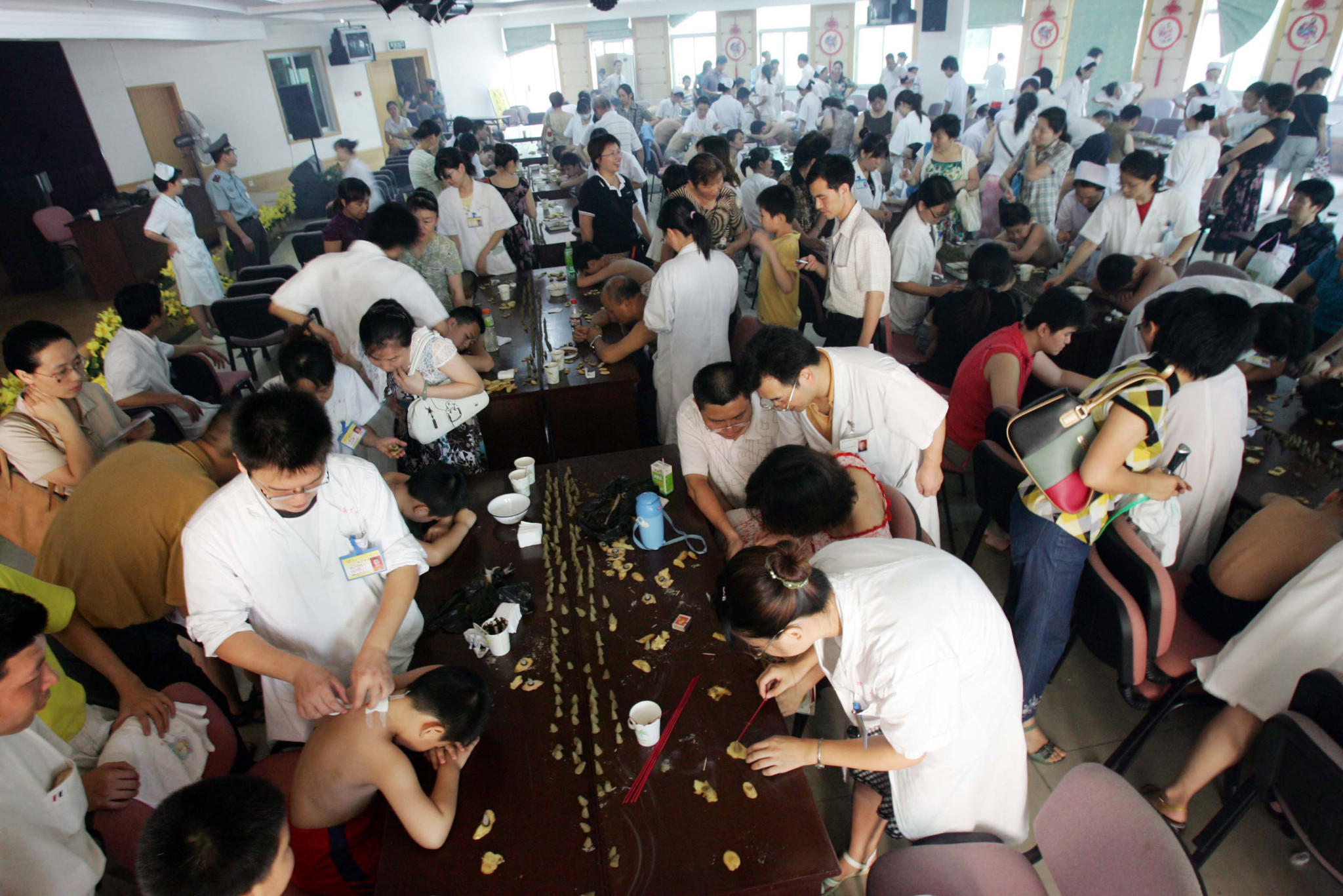 Doctors prepare herbal remedies during a mass treatment at a traditional Chinese medicine hospital in Fuzhou in southeast China's Fujian province.