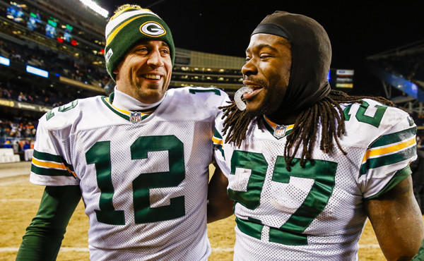 Green Bay teammates Aaron Rodgers, left, and Eddie Lacy smile as they walk off the field following the Packers' win over the Chicago Bears on Sunday. The Packers open the playoffs Sunday against the San Francisco 49ers.