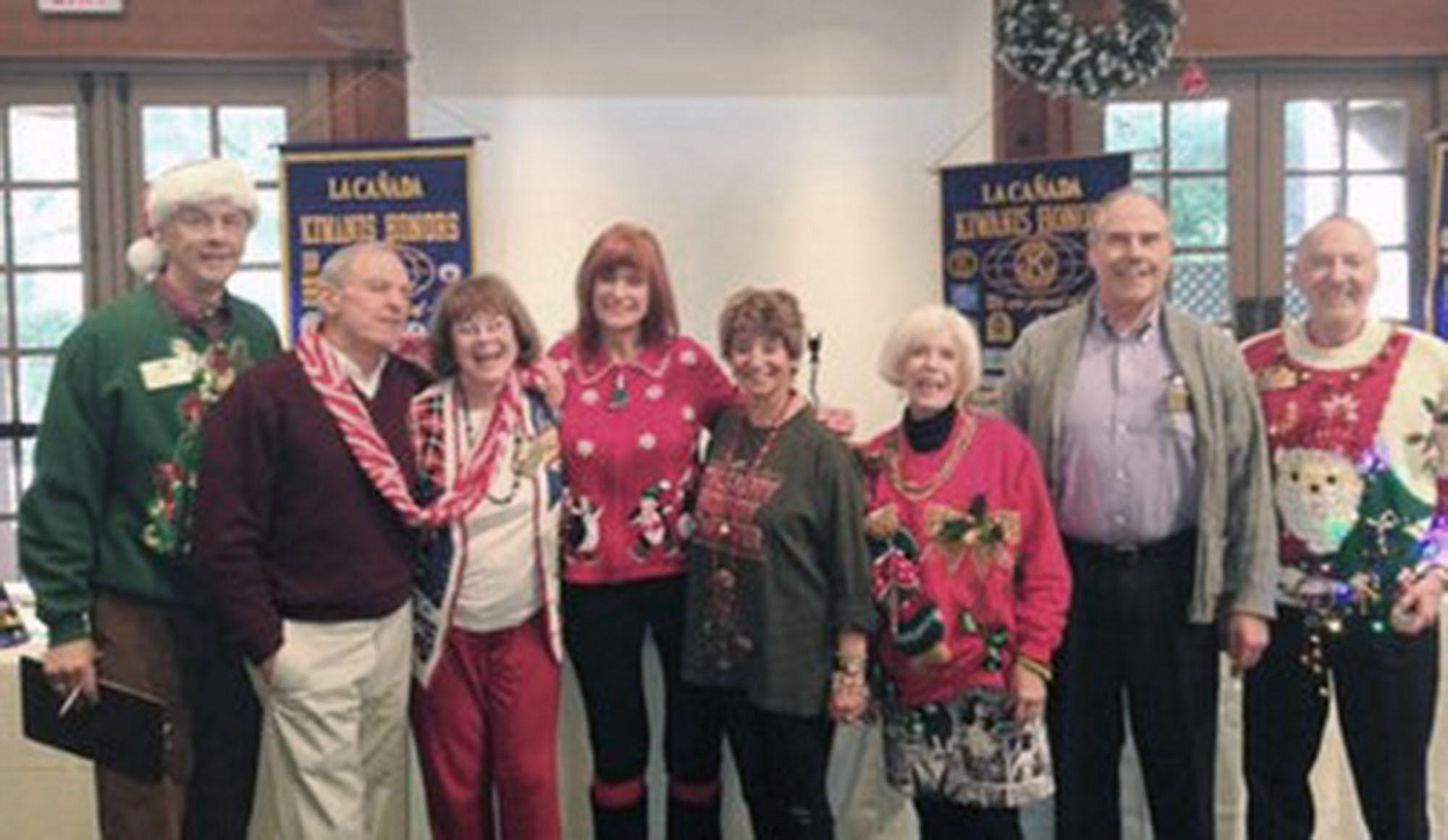 "Kiwanis members show off the ""ugly holiday sweaters"" they wear as part of their annual holiday tradition. From left to right: Kiwanis President Tom Passansi, Bill Koury, Eille Weldemuth, Diane Della Valle, Linda Magarian, Mary Gant, Rev. Skip Linderman, and the winner, Daryal Gant."