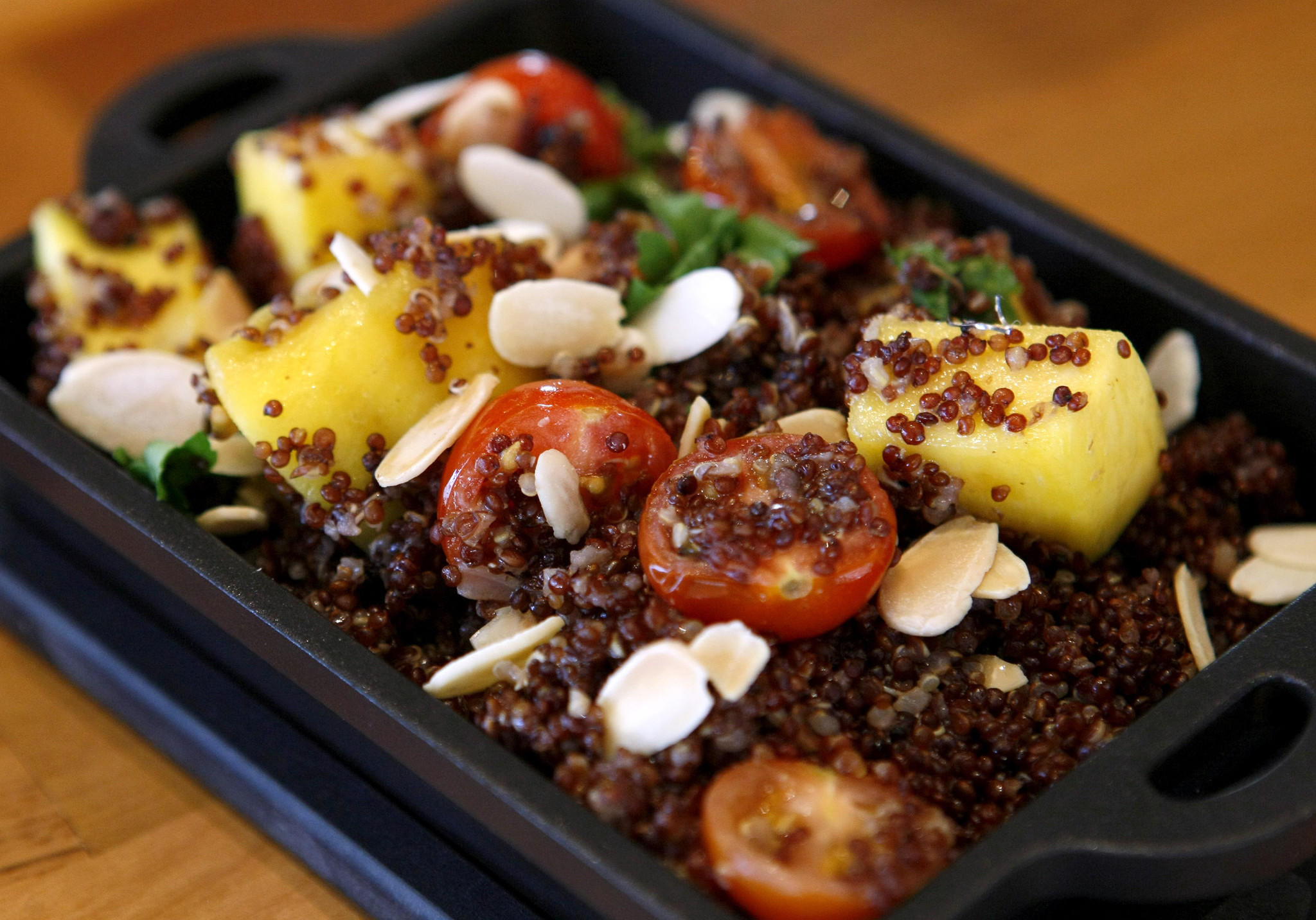 The Peruvian purple quinoa is served warm with shallots, Italian parsley, almonds and sauted mango, at Brand158 Restaurant & Bar in on the 100 block of S. Brand in Glendale, on Thursday, January 2, 2014.