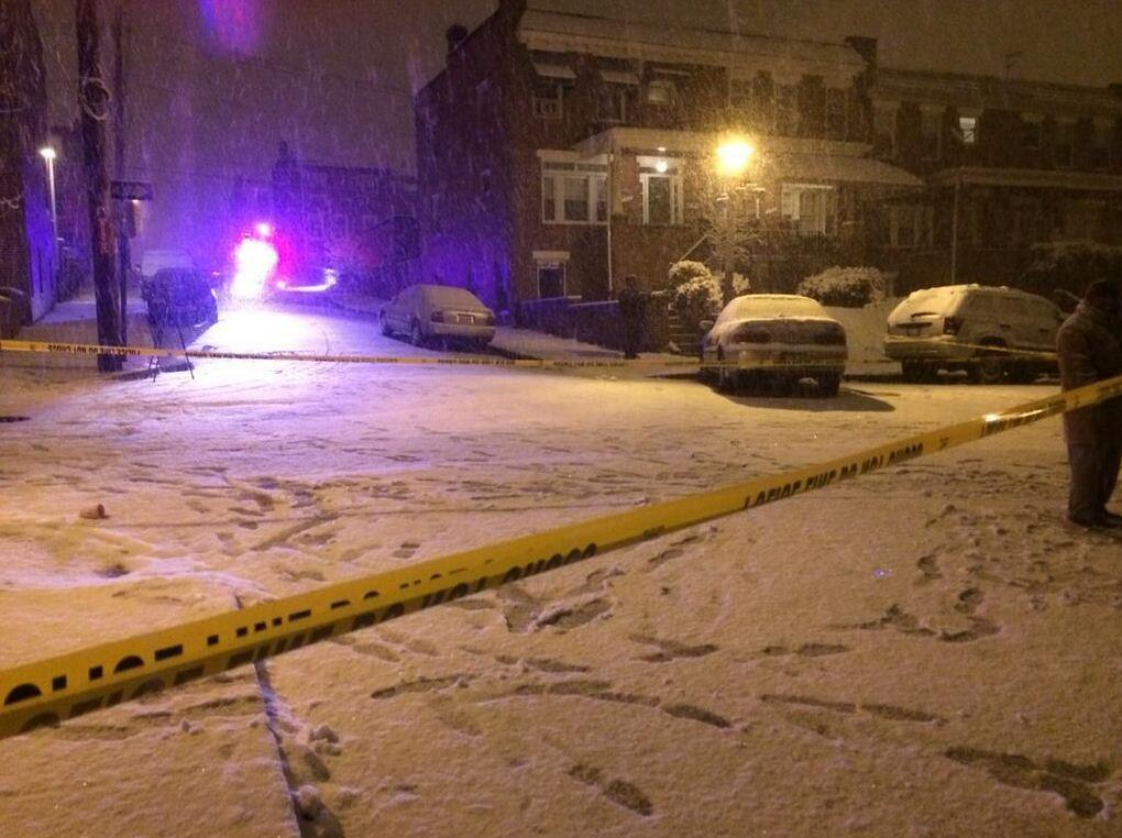 Baltimore Police investigate a shooting in the BelAir-Edison neighborhood amid Thursday evening's snow storm.