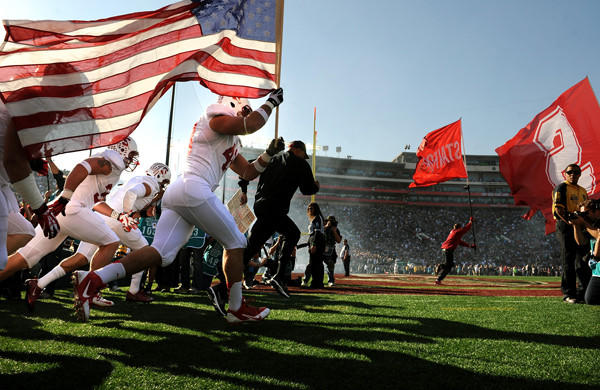 Stanford players run onto the field with the American flag before the start of Wednesday's Rose Bowl game with Michigan State. The venue may be the same, but the field will be brand new for Monday's BCS championship game between Florida State and Auburn.