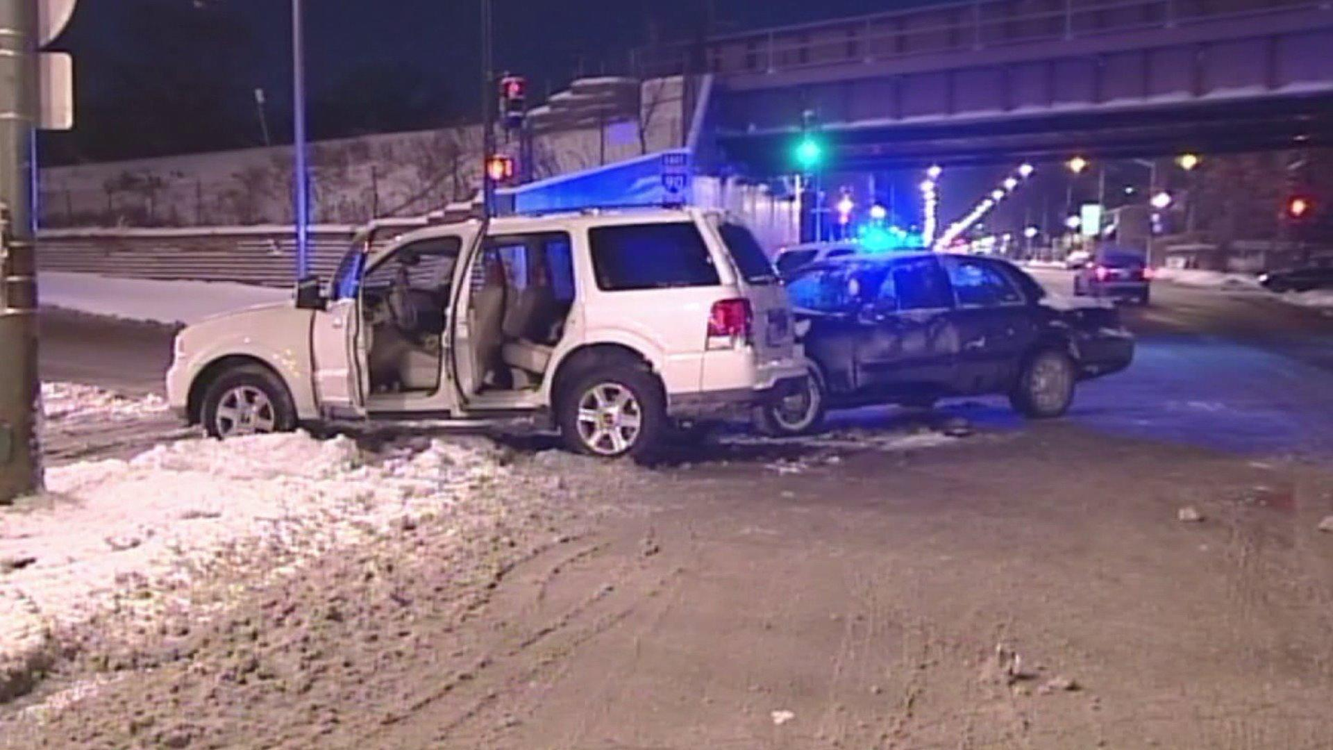 The aftermath of a collision between an unmarked police car and an SUV early this morning.
