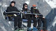 Putin arrives in Sochi to inspect Olympic venues, test ski slope