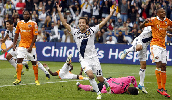 Mike Magee celebrates after a Galaxy teammate's goal during a victory over Houston for the MLS Championship.