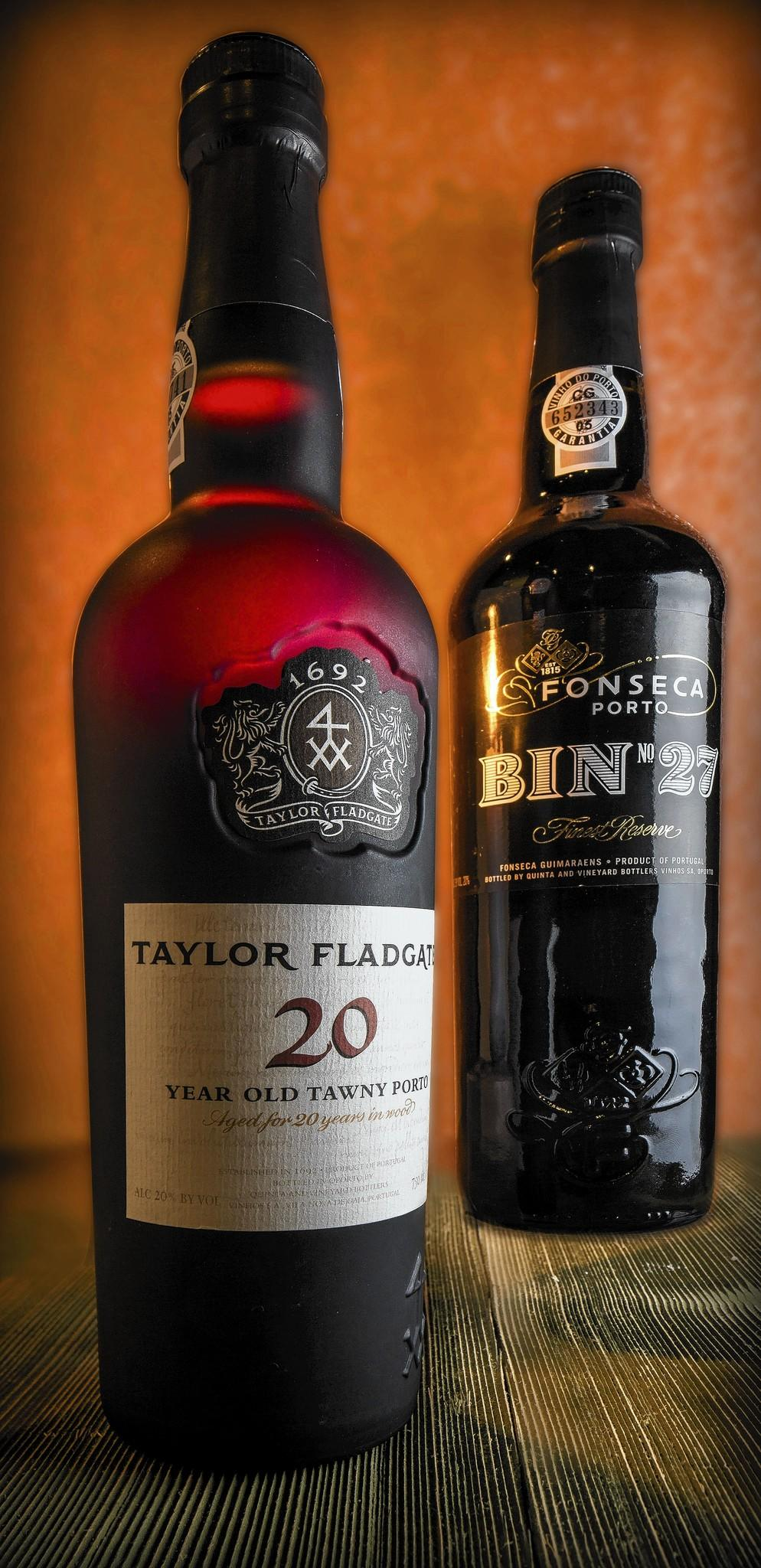 Two bottles of port -- Taylor Fladgate, 20 year old porto; and Fonseca Porto Bin #27