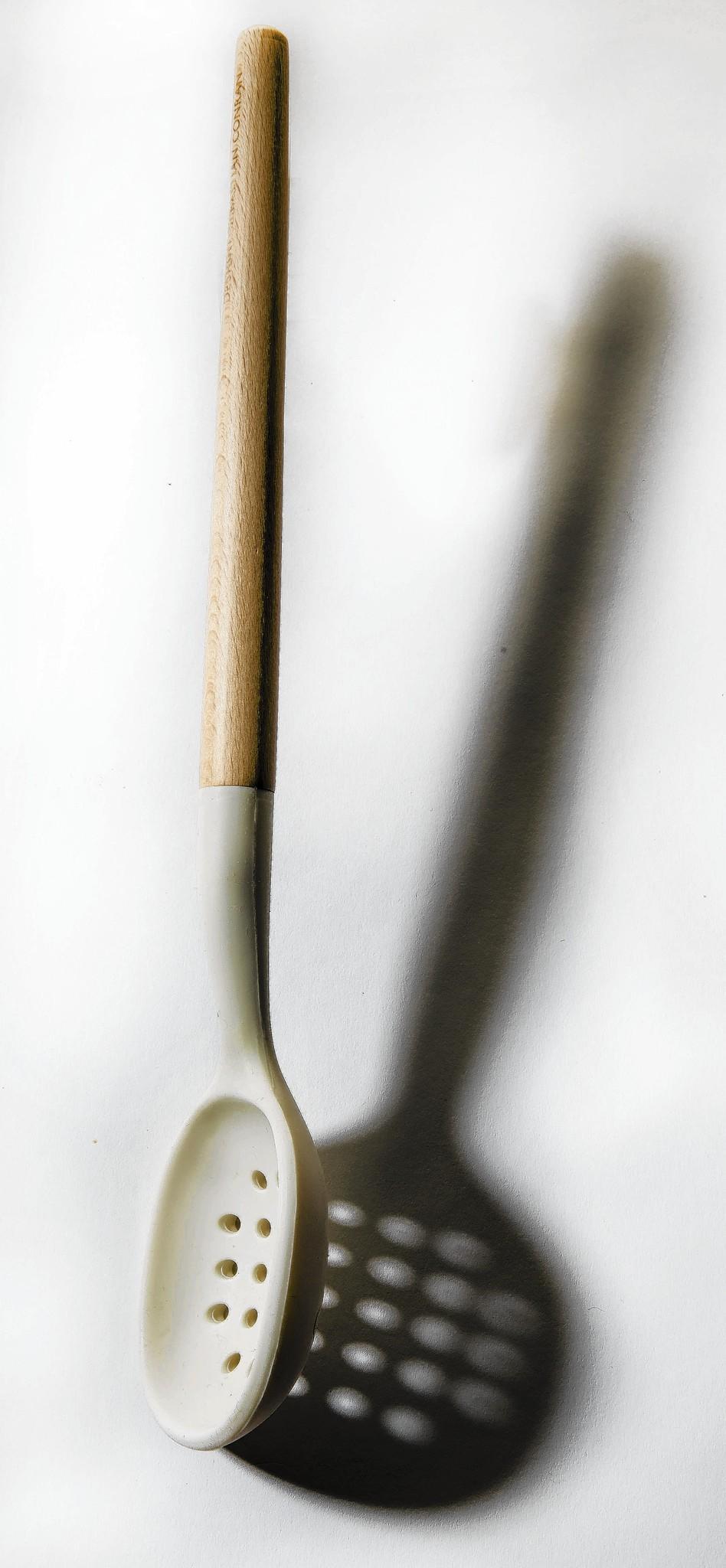 Silicone Slotted Spoon by British designer Sebastian Conran.