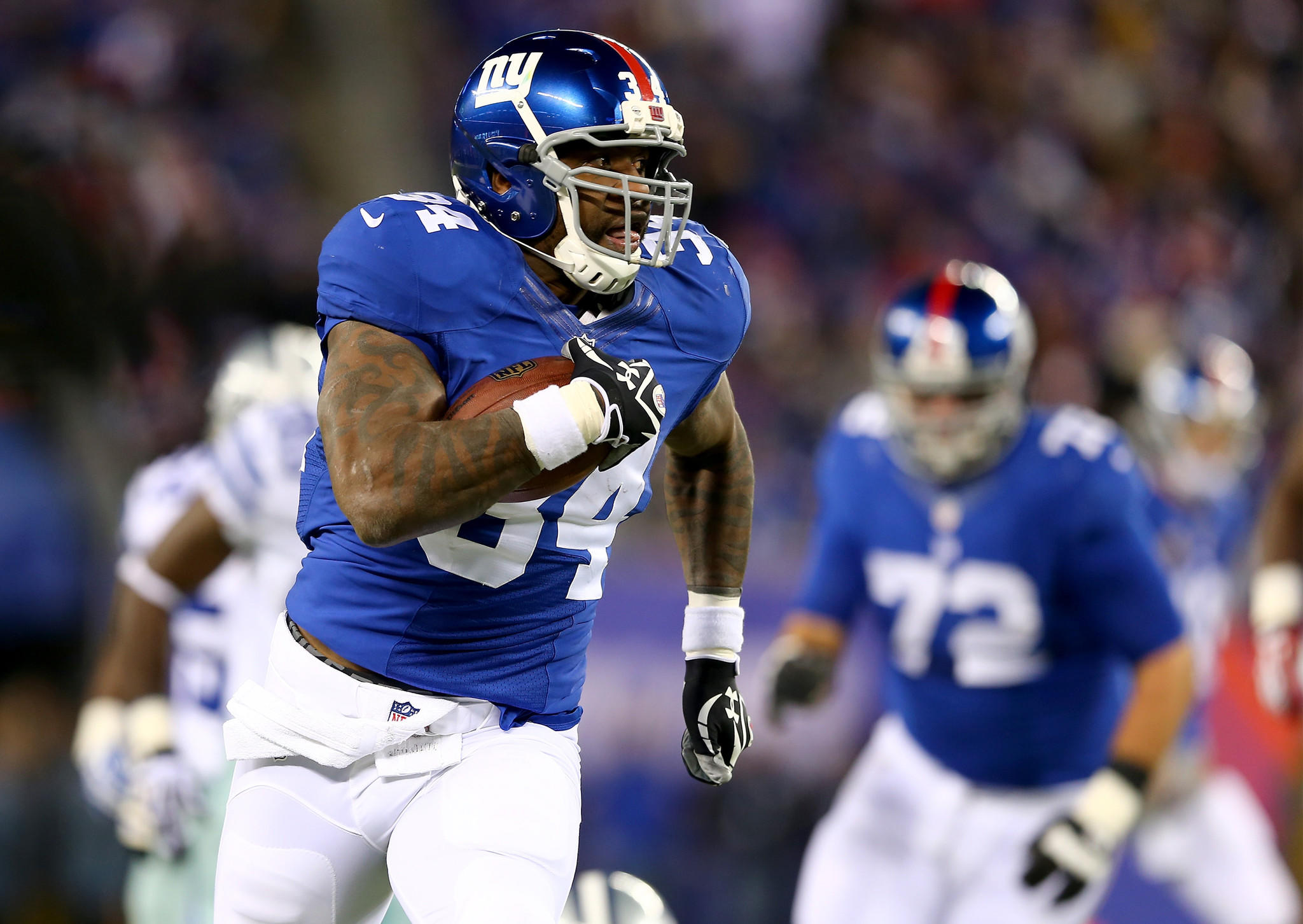 Brandon Jacobs of the New York Giants carries the ball in the second quarter against the Dallas Cowboys at MetLife Stadium on Nov. 24.