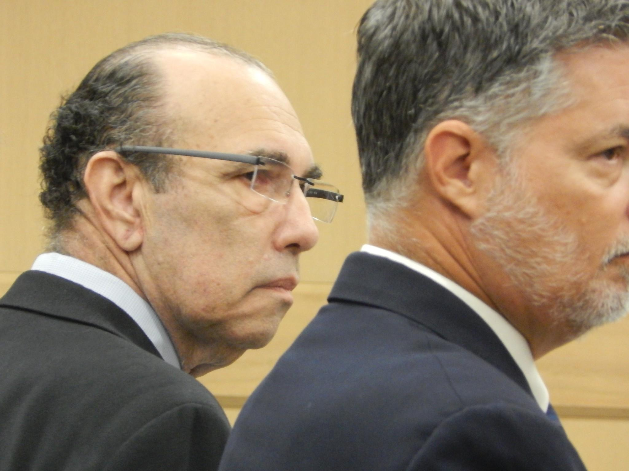 Robert Hittner, left, with attorney Frank Negron during a hearing Jan. 2, 2014. Hittner later pled guilty to three counts of fraud.