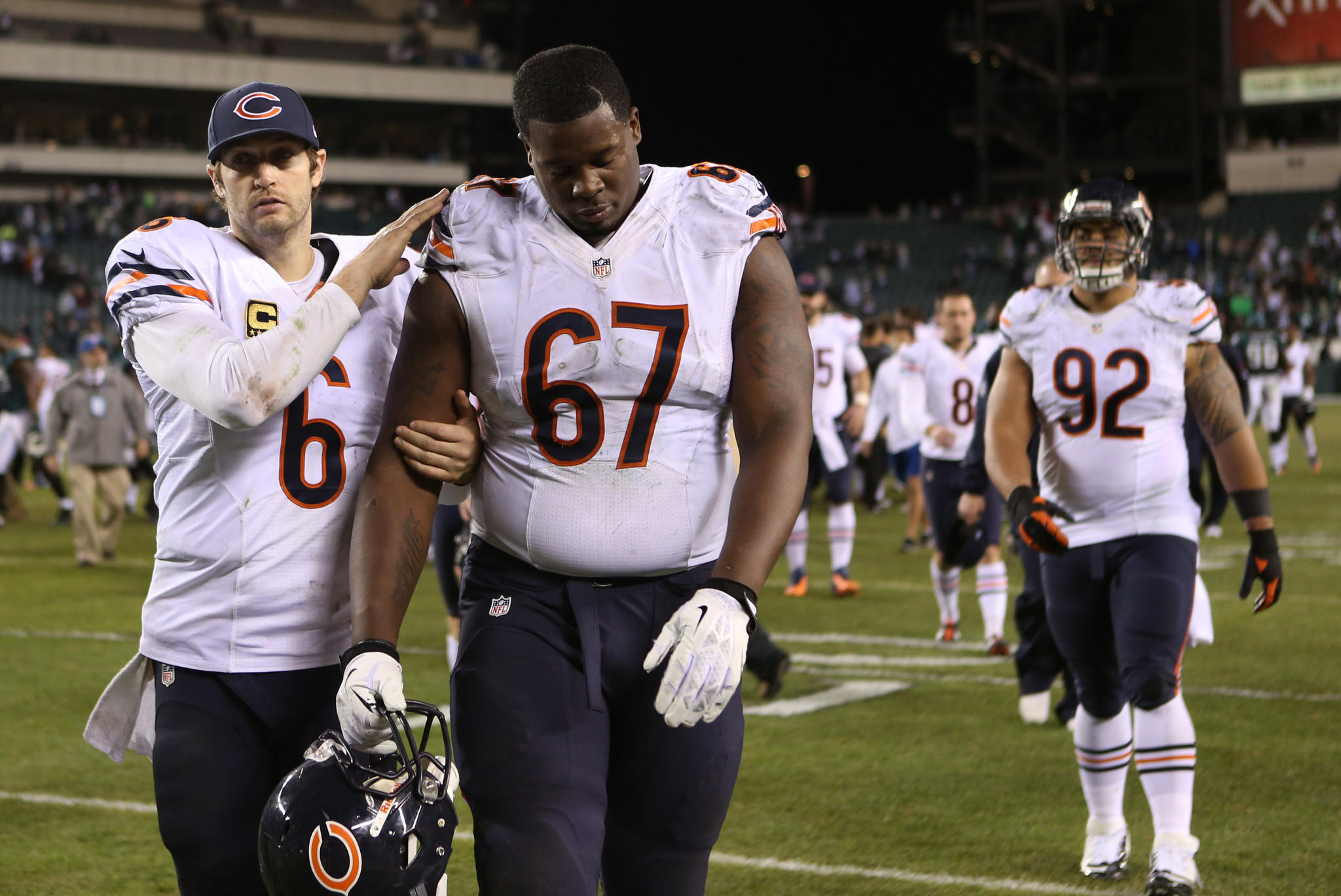 Chicago Bears quarterback Jay Cutler (left) consoles offensive tackle Jordan Mills after losing to the Eagles.