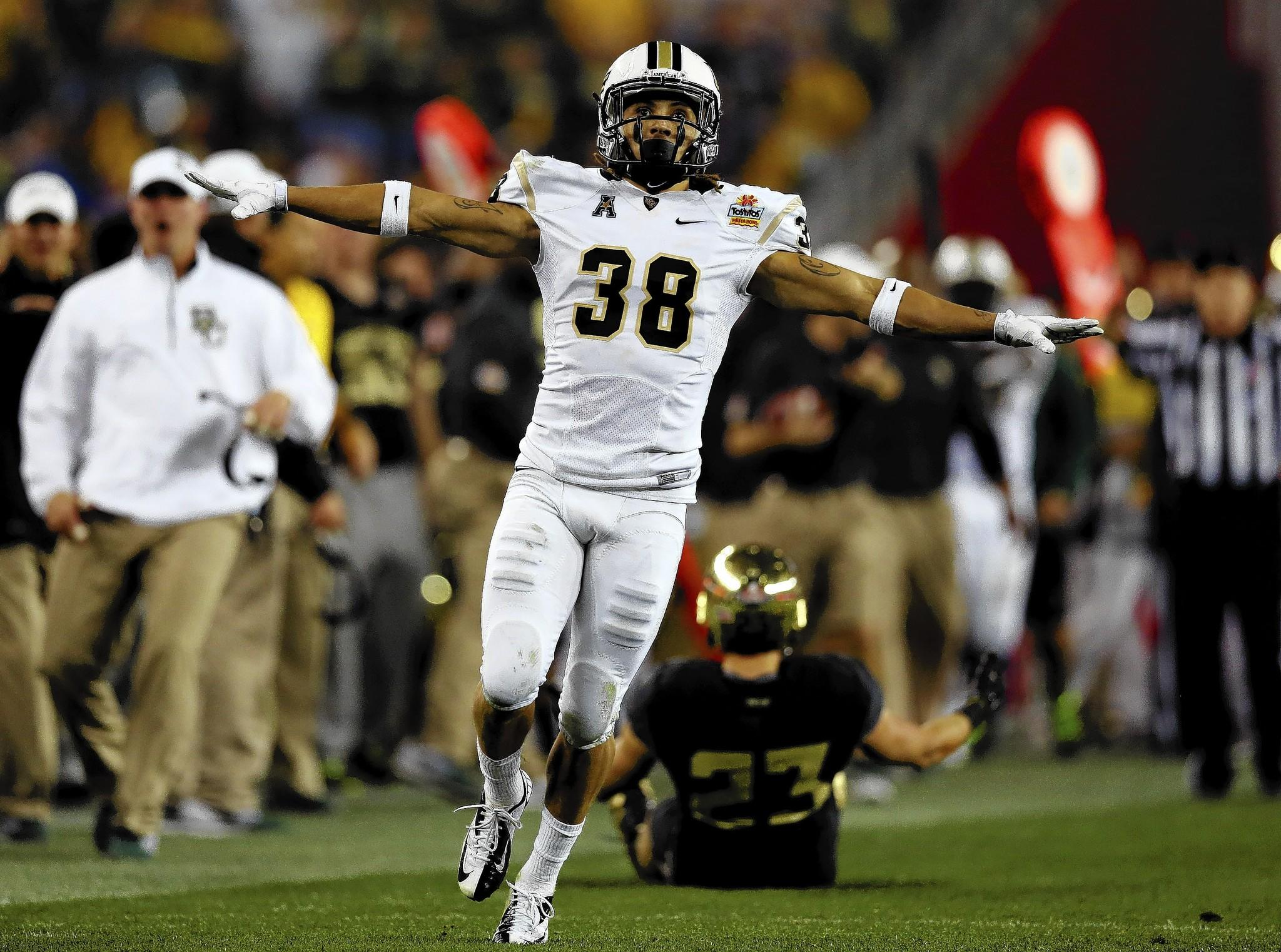 Defensive back Jordan Ozerities of the UCF Knights reacts after a broken up pass against the Baylor Bears during the Tostitos Fiesta Bowl at University of Phoenix Stadium on January 1, 2014 in Glendale, Arizona.