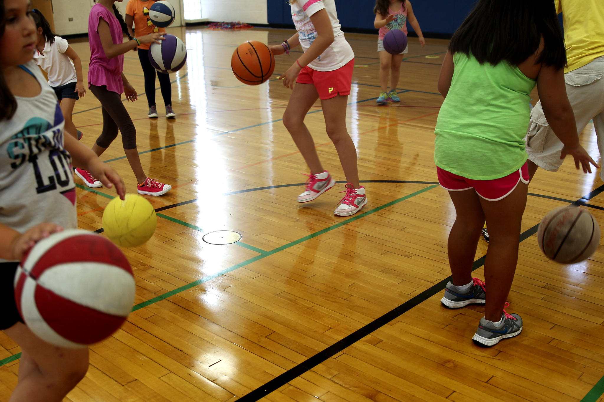 Girls play games with basketballs for the after school program through the Highland Park/Deerfield District 112 Education Foundation on Thursday, Sept. 19, 2013 in Highland Park, Ill.