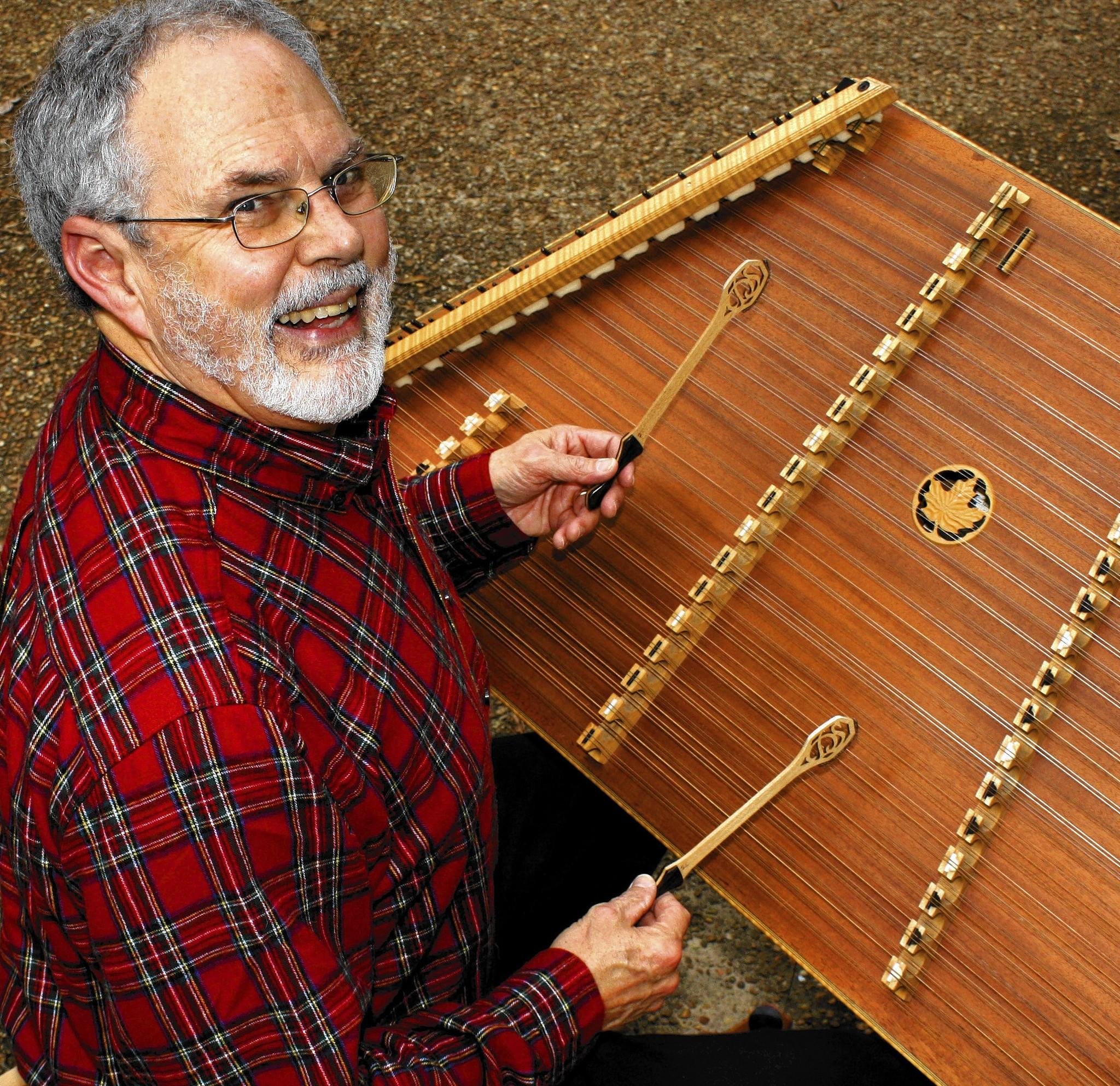 James City County resident Timothy Seaman has sold thousands of copies of his three holiday-themed CDs. They feature Seaman playing hammered dulcimer as well as flute and other instruments.