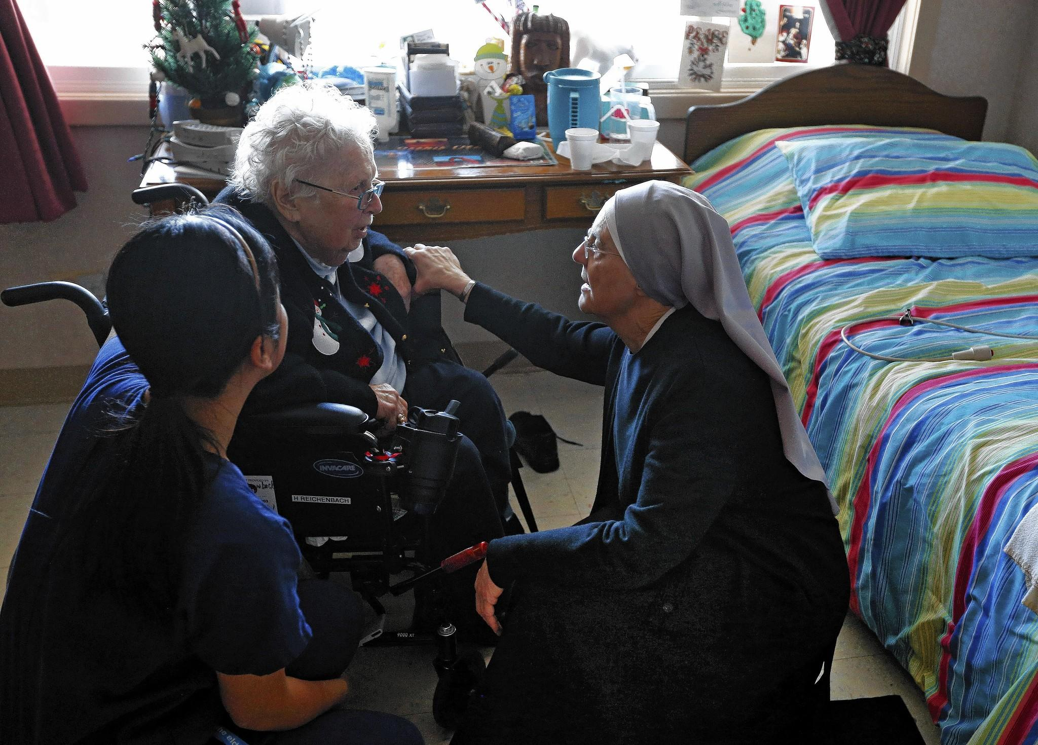 Mother Patricia Mary, right, and nurse Friary Nguyen visit Helen Reichenbach in her room at the Mullen Home for the Aged in Denver, run by the Little Sisters of the Poor. Justice Sonia Sotomayor temporarily blocked the Obama administration's contraceptive mandate at the nuns' request.