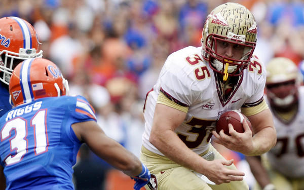 Florida State tight end Nick O'Leary (35) heads up field after a catch against Florida defensive back Cody Riggs during a game earlier this season.