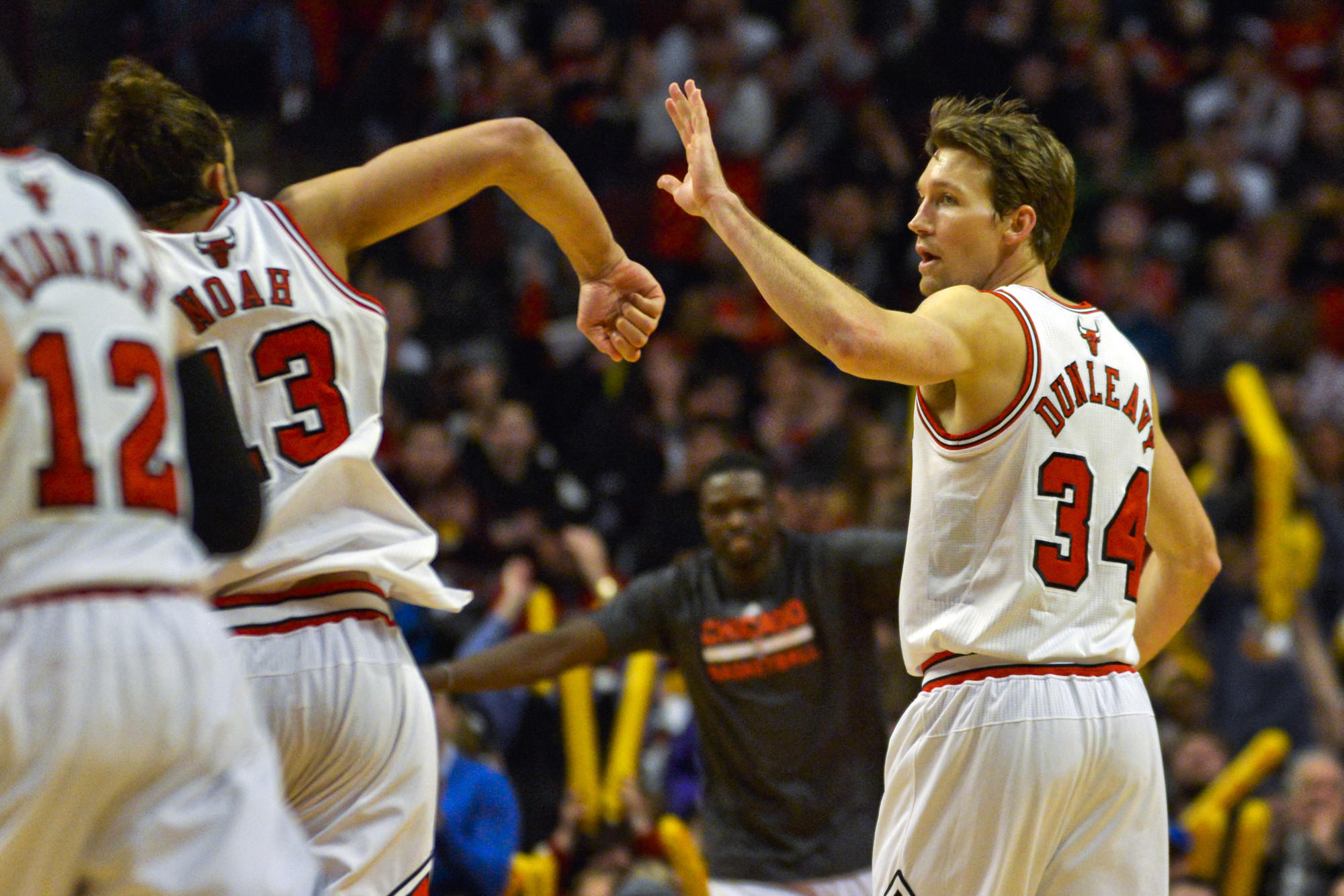 Mike Dunleavy and Joakim Noah celebrate against the Celtics during the second half.
