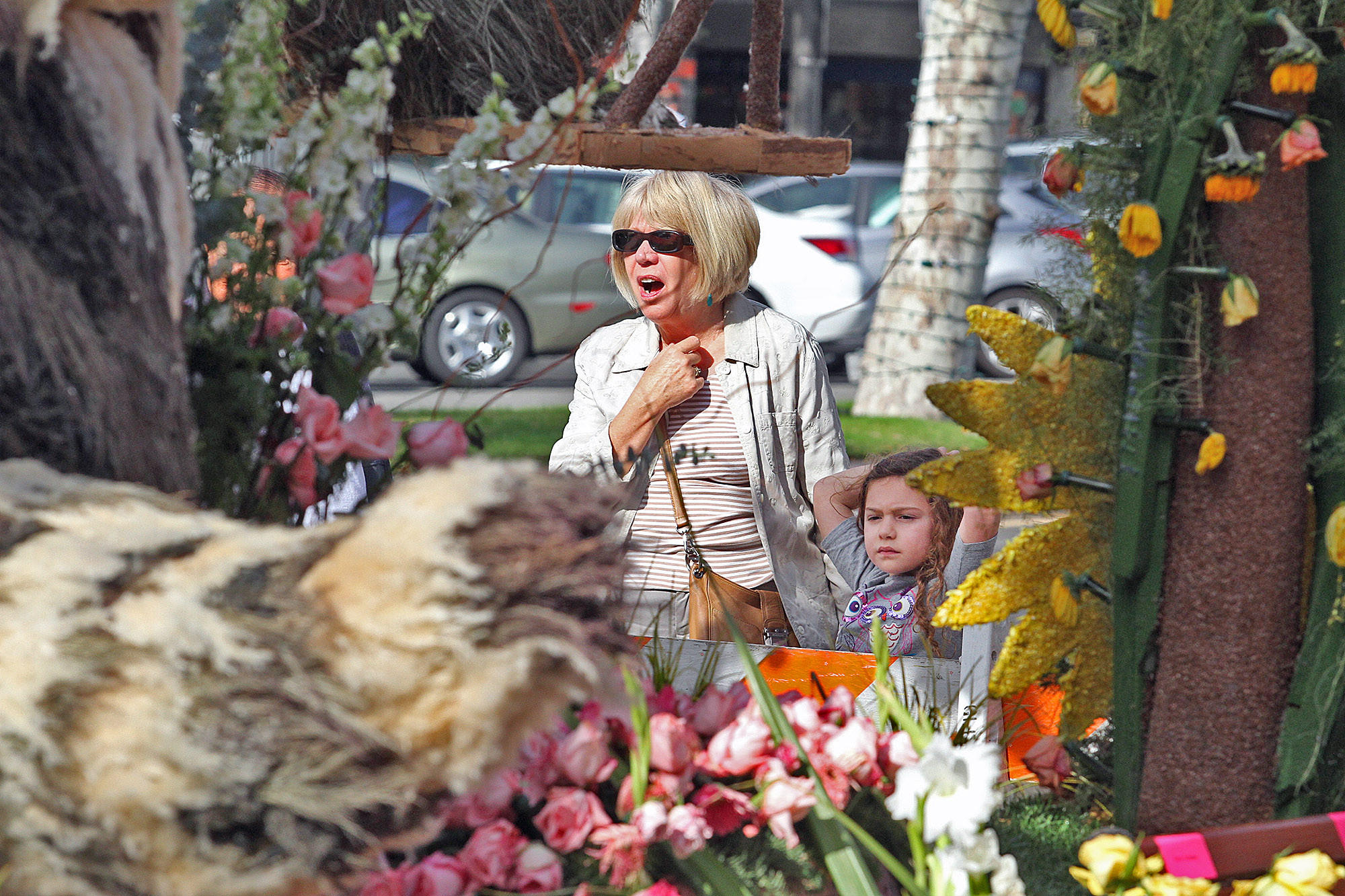 Leah Kamm of Los Feliz holds the hand of her grand daughter Mia Friedlander, 5, of Encino, as they look at the front of the Glendale Rose Parade float, set for viewing on Brand Blvd. in front of the Alex Theatre, on Friday, January 3, 2014.